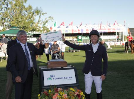 Kent Farrington accepts the winning prize from Mike Rose, Director & Chairman, President & CEO, Tourmaline Oil Corp