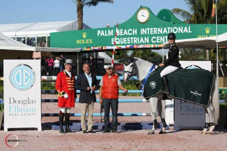 Kristen Vanderveen and Bull Run's Faustino de Tili in their  winning presentation with ringmaster Steve Rector, Todd Jenard  of Douglas Elliman Real Estate, and groom Luis Salazar.