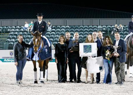 Lars Petersen and Mariett in their presentation ceremony with groom Mallory Brown, Mary Anne McPhail, Walter McPhail, Patrick Roggenbau, Bethany Peslar of Everglades Dressage, Endel Ots of Everglades Dressage, judge Gary Rockwell (USA), Marcia Pepper, and Allyn Mann of Adequan®.
