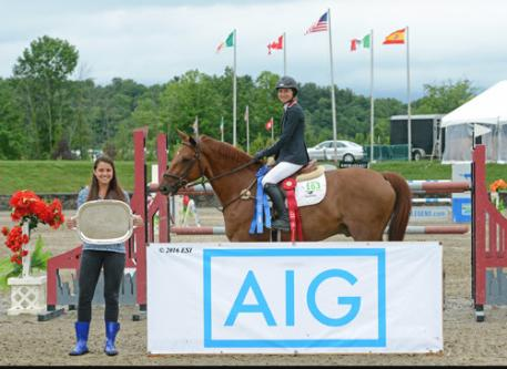 Laura Chapot and Quointreau Un Prince winning the  $75,000 AIG Grand Prix.