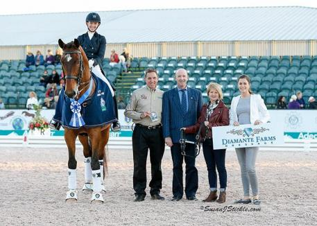 Laura Graves and Verdades in their presentation ceremony with Allyn Mann of Adequan®, judge Eddy de Wolff van Westerrode, Terri Kane of Diamante Farms, and Cora Causemann of AGDF.