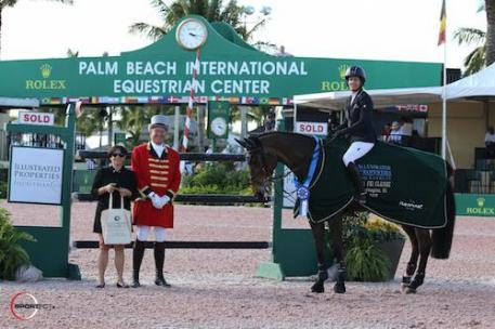Laura Kraut and Nouvelle in their winning presentation with Roberta Feinberg of Illustrated Properties and ringmaster Steve Rector.