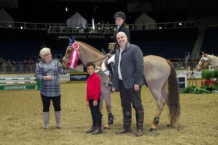 Laura Robertson of Toronto,ON, is joined by presenting sponsors Marion Cunningham and William Tilford of Marbill Hill Farm after winning the $5,000 Royal Pony Jumper Final on the final day of the Royal Horse Show®.