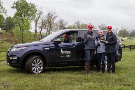 Lauren Kieffer (left) received the keys to a Land Rover Discovery Sport for the Land Rover Best Ride of the Day from Helen McDonald, Land Rover's events and partnerships manager (right), and TV personality Donna Brothers (center)