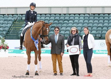 Leida Collins-Strijk and Don Tignanello in their presentation ceremony with judge Cesar Torrente, and Janet Richardson-Pearson of Chesapeake Dressage Institute, alongside Sponsorship Coordinator Cora Causemann.