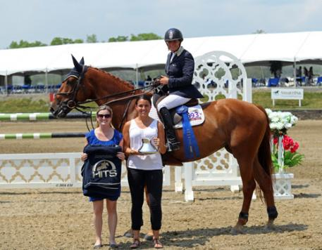 Leslie Burr Howard and Up and Blue Chapelle winning the $75,000 HITS Grand Prix.