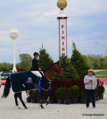 Lisa and Mary Goldman in the winner's circle with Sovereign.