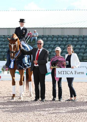 Lisa Wilcox and Galant in their presentation ceremony with judge Henning Lehrmann (GER), Janne Rumbough of MTICA Farm, and Cora Causemann of AGDF.