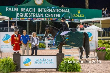 Liubov Kochetova and Balou Du Reventon in their presentation ceremony with ring master Steve Rector; Scott Glinski, Marketing & Communications Manager at Palm Beach County Sports Commission, and Lisa Lourie; partner of the Wellington Equestrian Partners (WEP).