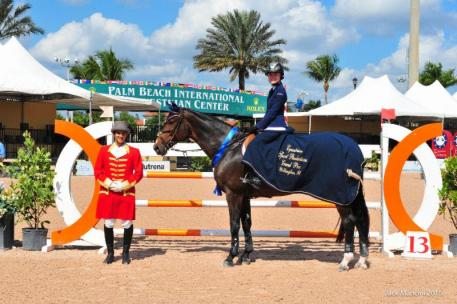 Liza Finsness and Shiver in their presentation ceremony for the $25,000 ESP Fall Finale Grand Prix