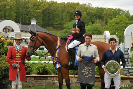 Lucy Deslauriers and Hester in their winner's presentation with ringmaster Alan Keeley and Rob Gray and Teddy Vlock representing T & R Development.