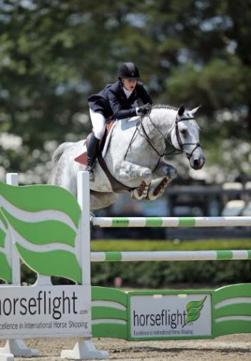 Lucy Matz, aboard Cardella, sailed to a 0,000 Jr/A-O Jumper High Classic, presented by Vetera ® XP Vaccines win at HITS Culpeper Winston National.
