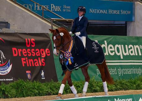 Malena Brisbois and her homebred Swedish Warmblood gelding Amadeus won a tiebreak to claim the First Level Freestyle Adult Amateur Championship at the 2016 US Dressage Finals presented by Adequan®.