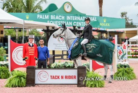 Marilyn Little and Clearwater in their presentation ceremony with ring master Steve Rector alongside Amit Ramani, owner of TACKNRIDER.