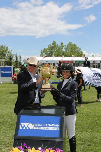 Mckayla Langmeier in her winning presentation with George Brookman, CEO West Canadian.