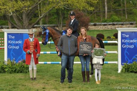 McLain Ward and HH Carlos Z in their winner's presentation with ringmaster Alan Keeley, as well as Brian and Gretchen Kincade and Ella Kwon, representing The Kincade Group.