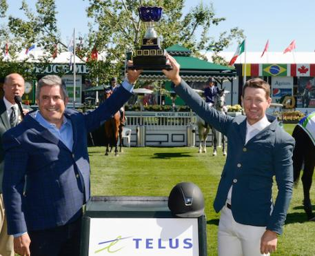 McLain Ward raises his winning trophy with Craig Mason, Vice President, Sales & Experience, Dealers & Channels, TELUS.  (Photo: © Spruce Meadows Media Services)