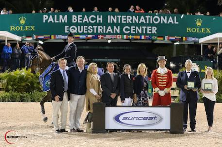 McLain Ward and HH Azur in their winning presentation with Jim Wolf;  Equestrian Sport Productions CEO Mark Bellissimo; Wellington Equestrian  Partners principal Katherine Bellissimo; Tom, Lauren and Jeannie Tisbo of  Suncast®; ringmaster Christian Craig; Double H Farm's owner Hunter Harrison;  and Elizabeth Grant, National Events Associate, Rolex Watch U.S.A.
