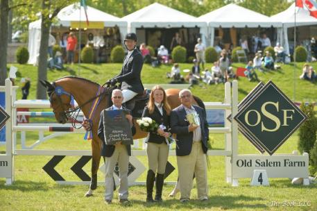 McLain Ward in his winner's presentation with Bruce Thompson representing The Town of North Salem, Kyle Olson, and Kamran Hakim of Old Salem Farm.