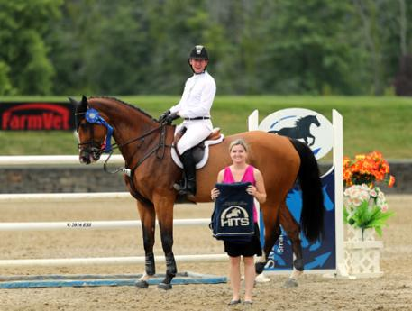 Mclain Ward accepting the award for first and second place aboard Zerly in the $25,000 SmartPak Grand Prix.