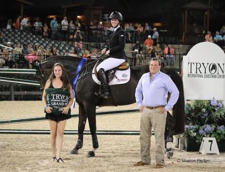 Meagan Nusz and SRI Aladdin in their winning presentation with TIEC Partner Howard Dvorkin and his daughter, Carly Dvorkin.