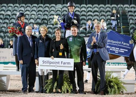 The FEI Grand Prix Freestyle CDIO 3* podium with winner Megan Lane, Equestrian Sport Productions President Michael Stone, Tuny Page of Stillpoint Farm, Cora Causemann of AGDF, Allyn Mann of Adequan®, and judge Thomas Lang.