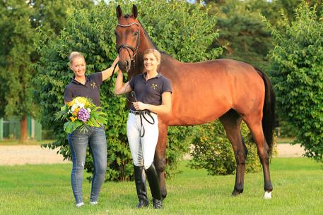 From Australia: Melanie Schmerglatt (right) with her permanent groom and friend Gianna Rohlfs after a successful auction.