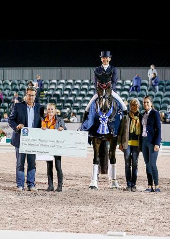 Mikala Gundersen and My Lady in their presentation ceremony with Thomas Baur of AGDF, groom Julie Albrechtsen, Janne Rumbough, and Cora Causemann of AGDF.