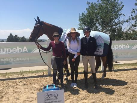 Omega Alpha Healthy Horse winner week 5 Carly Anthony and Chacco receiving their award.