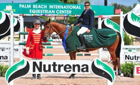 Paul O'Shea in the presentation ceremony for the $25,000 Nutrena Spring I Grand Prix with ringmaster Christian Craig.