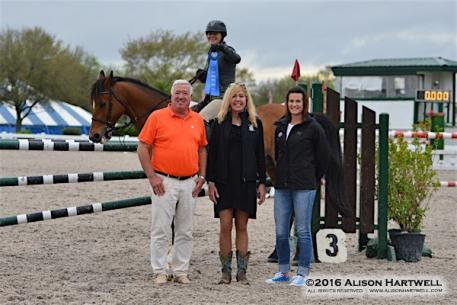 A beaming Brennan proudly displays her blue ribbon in the irons of Japan.  Brennan was joined by Gulf Coast Classic President, Bob Bell, Sponsorship Director Lisa Engel and Awards Coordinator, Drew Coster