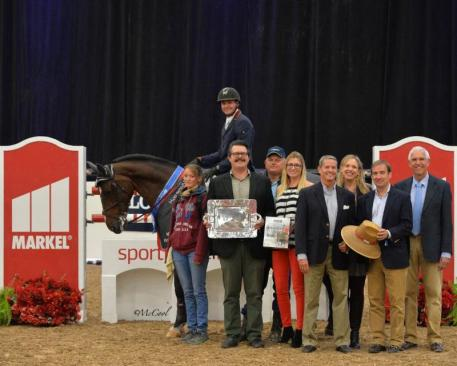 Peter Petschenig and Saint Quentin celebrate the win in the Markel Grand Prix Series Final with (l-r) their groom Deborah Kunath, Director of Equine Operations for Markel Insurance Brandon Seger, Petschenig's coach Allen Clarke, Lauren Davis of EquiFit, inc., and Markel Insurance's Chris Norden, Julian Bowan-Rees and John Seger