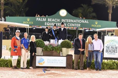 Kristen Vanderveen, Margie Engle, and Beat Mändli in their presentation ceremony with ring master Steve Rector; Scott Glinski, Marketing & Communications Manager of Palm Beach County Sports Commission; Beth & Keith Vanderveen; and Mark & Katherine Bellissimo of Wellington Equestrian Partners.