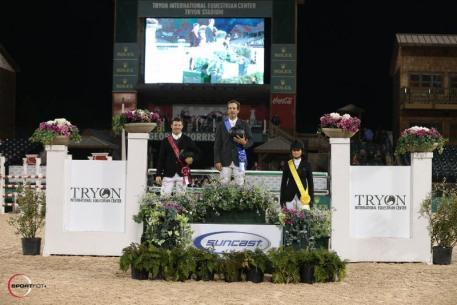 Andy Kocher, Shane Sweetnam, and Adrienne Sternlicht in their presentation ceremony following the 30,000 Suncast® Grand Prix CSI 3*.