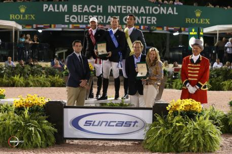Eric Lamaze, McLain Ward, and Sergio Alvarez Moya in the top three presentation with Kyle Younghans, Sports Marketing Manager, Rolex Watch USA; Mark and Katherine Bellissimo of Equestrian Sport Productions; and ringmaster Steve Rector.