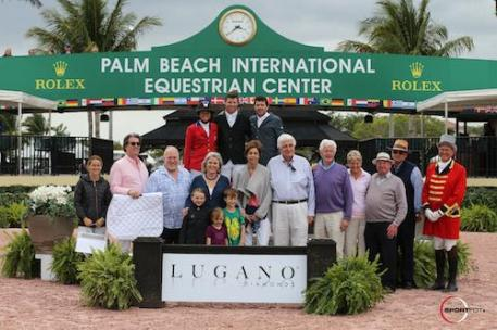 Ali Wolff, Shane Sweetnam, and Conor Swail in their winning presentation with Ariel Bluman, Craig Dickmann, Director of Equestrian,and Stuart Winston, Chief Marketing Officer, Executive Director of Retail, Lugano Diamonds; Lisa Lourie of Spy Coast Farms; Olivia, Lucy, and Collin Sweetnam; Tina and Bill Justice; Jerry and Maria Sweetnam; Noel Phelan; Michael Stone, President of Equestrian Sport Productions; and ringmaster Steve Rector.