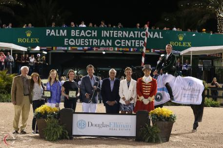 ichie Moloney and Carrabis Z in their winning presentation with Richie's father, Tom Moloney; Carrabis Z's owners, Diana and Jenji Mercer; Augusta Shifflett, Public Relations representative, Rolex Watch USA; Don Langdon, Managing Broker for Palm Beach & Wellington, Douglas Elliman; Howard Lorber, Chairman, Douglas Elliman; Nicole Oge, Chief Global Marketing Officer, Douglas Elliman; and ringmaster Christian Craig.