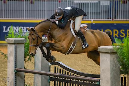 Ryan Roy of King City, ON, and Bayridge, owned by Doug Bannister, was runner-up in the 5,000 Braeburn Farms Hunter Derby at the 2015 Royal Horse Show®