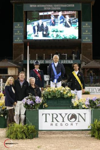 Samuel Parot in his presentation ceremony with Leslie Howard, Ignacio Maurin, Mark & Katherine Bellissimo, and Sharon Decker, COO of Tryon Equestrian Partners, Carolinas' Operation.