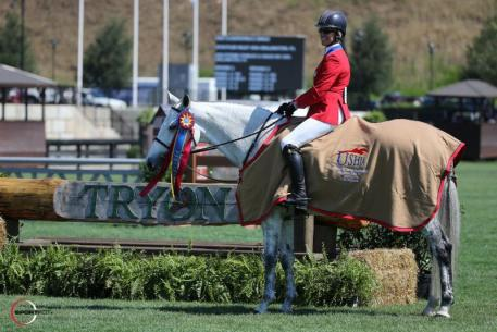 Schulyer Riley and Cleopatra's Smile in their presentation ceremony on the Grass Complex at TIEC.