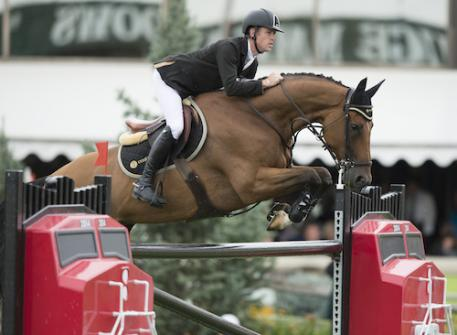 Scott Brash of GBR riding Hello Sanctos during the .5 Million CP International, presented by Rolex, at the Spruce Meadows Masters.