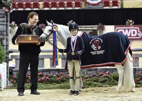 Sophie Gochman and Love Me Tender in their award presentation after winning  2015 Grand Champion Pony Hunter honors