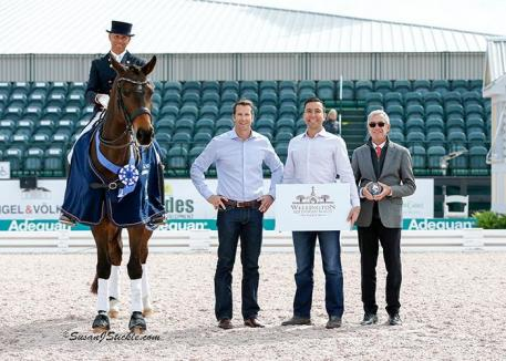 Steffen Peters and Rosamunde in their presentation ceremony with Craig Martin and Rob Desino of Wellington Equestrian Realty alongside judge Gary Rockwell.