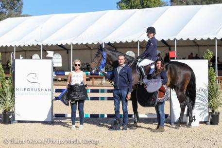 Susan Hutchison and Notable accept their Meyer Selles saddle from Eric Navet.