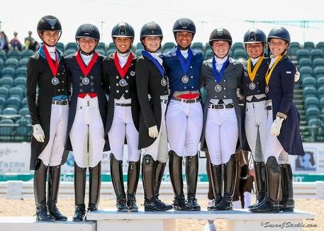 USA Team A, USA Team B, and Team Canada pose together atop the podium after receiving their medals in the inaugural FEI Under 25 Nations Cup CDIO 3* presented by Diamante Farms at the Adequan® Global Dressage Festival (AGDF).