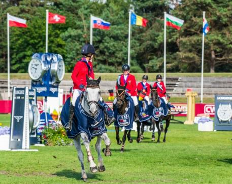 Longines FEI European Championships™ Fontainebleau for CH-J-YR 2018 Gold team in Children class (Jumping): Leading on grey horse is Chiara Reyer then Mikka Rotha then Mick Haunhorst and Charlotte Hoing at the end. (Photo: FEI/Łukasz Kowalski)
