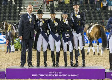 Chef d'Equipe Klaus Roeser (left) with the gold medal winning German Dressage team - Isabell Werth, Dorothee Schneider, Helen Langehanenberg and Sonke Rothenberger - on the podium at the Longines FEI European Championships 2017 in Gothenburg, Sweden tonight.