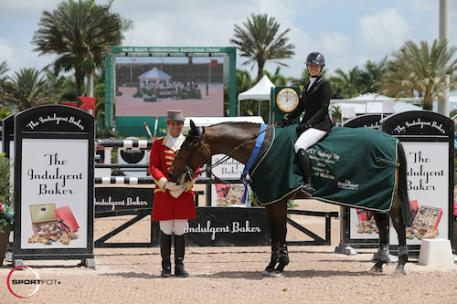 Tiffany Foster and Victor in their winning presentation with ringmaster Christian Craig.