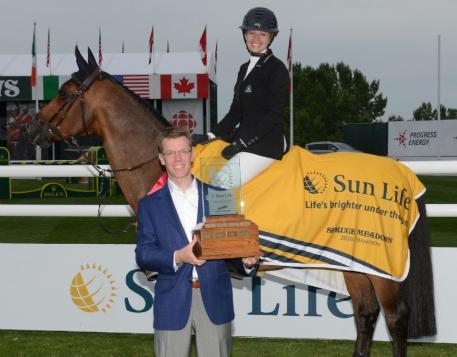 Tiffany Foster and Brighton in their winning presentation with Dave Jones, VP, Business Development, Sun Life Financial.