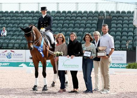 Tinne Vilhelmson-Silfven and Esperance in their presentation ceremony with Susan Guinan of Vinceremos Therapeutic Riding Center, Cora Causeman of AGDF, Mary Anne McPhail of the Palm Beach Dressage Derby, judge Elke Ebert (GER), and FEI Steward Walter Bagley.